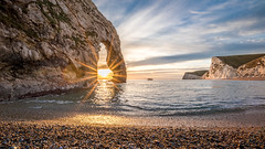 Shining through! (Nathan J Hammonds) Tags: durdle door dorset uk britain coast sea beach pebbles sun sunset cliffs water sky hdr irex 15mm f24 nikon d750 seascape
