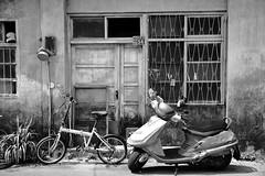 The Bikes (superzookeeper) Tags: 5dmk4 5dmkiv canoneos5dmarkiv ef2470mmf28liiusm eos digital street taiwan formosa beipu oldtown oldtownbeiput blackandwhite bnw monochrome hsinchu oldhouse bike motorbike moped bicycle tw over1000views