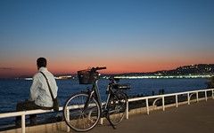 A lonely man in a deep thought (mahmoudchakrane) Tags: nice sunset man beach promenadedesanglais france frenchriviera bicycle deep thought lonely