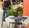 Potted cafe corner (enthusiast photographer) Tags: pentax pentaxk1 smctakumar135mmf25 takumar outdoor plant urn table chair railing step
