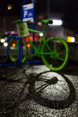Unpainted shadow of a painted bike (tom.leuzi) Tags: 50mm bike bokeh canoneos6d dof fahrrad lichter nacht night sigma50mmf14dghsmart schatten schweiz sigmaart switzerland velo bicycle bus f14 green lights outoffocus shadow street flickrfriday gogreen