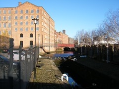 Manchester🐝🐝🐝🐝🐝🐝🐝🐝🐝🐝 (rossendale2016) Tags: links transport barge path pathway banks walkway footbridge bridge modernising refurbished factory mill apartments river water steps lock canal manchester