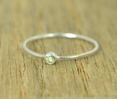 **Free Domestic Ship (alaridesign) Tags: free domestic shipping for all orders over 50 use coupon code shipfree50tiny sterling silver peridot mothers ringdainty rustic original tiny 2mm handmade alari importedfrometsy importedfrometsy1704 jewelry ring
