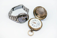 Old Pocket Watch And Titan watch isolated on the white background (wuestenigel) Tags: dial close date mans lid numerals accessory minute opened openup wrist details classic closeup clockworks background isolated titan luxury over swiss metal measuring strap minutes antique chronological clockwise white number cover pocket calendar hinged face hour stainless hours personal time vintage single watch jewelry piece factory retro man roman chrome wristwatch antiquated expensive bracelet stilllife object clock steel yellow elegance shiny