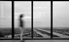 Framed (CoolMcFlash) Tags: person woman framed window vienna dctower bnw blackandwhite blackwhite monochrome streetphotography candid walking motion blur canon eos 60d frau fenster rahmen wien schwarzweis sw bw gehen bewegung bewegungsunschärfe fotografie photography tamron b008 18270