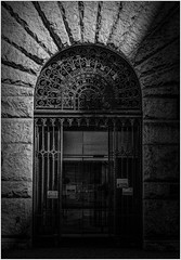 Gate (ronnymariano) Tags: stone iron bnw ir facade old landmark art city victorianstyle 2016 styled entrance door cultures blackandwhite window obsolete architecturalelement infrared arch builtstructure pittsburgh history architecture gate antique buildingexterior oldfashioned ornate