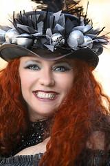 Christmas Hat (wyojones) Tags: texas galveston dickensonthestrand holidayfestival hat blackandsilver hair redhair redhead lady lovely woman beautiful beauty feathers smile pretty curls blueeyes