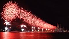 UAE National Day - Abu Dhabi (keltia17) Tags: uae abudhabi fireworks feuxdartifice fuegosartificiales eau emiratos emirates emirats red sea water reflection reflets reflejos rojo rouge noir black negro