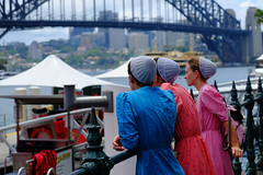 Who are they? (cupitt1) Tags: bridge sydney harbour nsw australia fuji xpro1 women young coulourful dresses long hats view watching group gowns amish quakers brethren religious sect