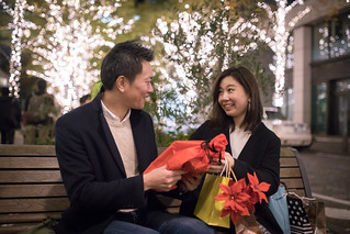 Husband giving present to wife at Christmas night