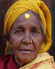Nepali Woman (posterboy2007) Tags: bhaktapur nepal woman nepali portrait availablelight yellow elderly sony sonyrx100m3