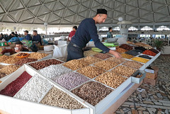 Nuts & Fruits For Sale (peterkelly) Tags: uzbekistan tashkent market bazaar canon 6d digital gadventures centralasiaadventurealmatytotashkent man seller vendor hat dried fruit nuts produce