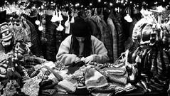 festive market at night 01 (byronv2) Tags: edinburgh edinburghbynight night nuit nacht festivemarket christmasmarket market princesstreetgardens princesstreet mound newtown blackandwhite blackwhite bw monochrome peoplewatching candid street winter stall shop shopping