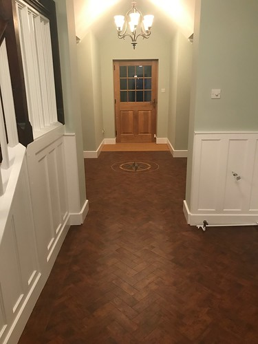 Amtico hallway in herringbone in Priory Oak with a motif