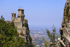 Castello della Guaita on the clifftop in San Marino (B℮n) Tags: monumento bartolomeo borghesi universityoftherepublicofsanmarino adriatic sea sanmarino cittàdisanmarino montetitano is land clifftop castlesis enigmatic mysteryis vertiginous views castle slopes mountain republic tourist vacation hills ridge viewpoint clifftops unesco panorama state visiting summer steep trees church palazzopublicco monte titano castellodellaguaita medieval stone wall rooftops cestatower seconda torre 50faves topf50