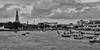 View from Memorial Bridge over the Chao Phraya River (Thomas Mulchi) Tags: thonburi bangkok thailand 2017 thadindaengphotowalk bpg bangkokphotographersgroup photowalk chaophrayariver viewfrombridge monochrome bw boats temples krungthepmahanakhon th 21