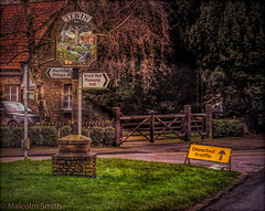 Tewin (M C Smith) Tags: village sign green gate building car parked road roads yellow pentax k3 arrows letters numbers painting wood trees brown hertfordshire tewin windows