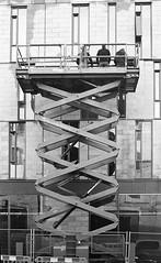 Three men on a lift (Man with Red Eyes) Tags: 3 three threeofakind lift builders berggerpancro400 bergger pyrocathd 11100 16mins analog analogue blackwhite monochrome silverhalide sunnysixteen lancaster lancashire northwest