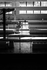 Railway Station 2 (amargureiro) Tags: blackandwhite bw people station train transportation urban city monochrome blancoynegro tren lines geometry light naturallight buildings lonelyness waiting moody backlighting nikon