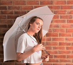 Under her umbrella. (pstone646) Tags: youngwoman younglady beauty people portrait pretty longhair brownhair studio