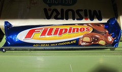 Candy bar cannibalism? (MFinChina) Tags: china shanghai food name strange cookies filippino philippines chocolate packaging