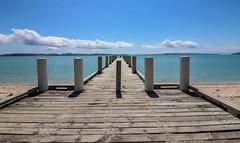 Maraetai Wharf (Andy.Gocher) Tags: maraetai wharf andygocher canon100d newzealand beachlands sky clouds water beach bluesky blue green ngc