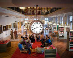 Once Upon A Time (DobingDesign) Tags: books reading library storytime storytelling stories learning listening people together audience clock numbers romannumerals clockhands oclock killingtime london londonmuseum readinggroup meeting room readingroom ceiling sculptures collection cushions furnishings areyousittingcomfortably comfy