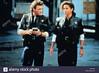 TIMECOP, 1994 (jessygianstbane) Tags: entertainment orientationlandscape stoodhalfbody filmstill action scifi inuniform police