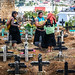 Tzotzil (Maya) women preparing the cemetery for the Day of the Dead. San Juan Chamula. Chiapas, Mexico