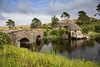 New Zealand - Mill house at the end of the bridge (Hobbiton) (mho.online) Tags: canon eos 6d ef2470mmf14lisusm new zealand north island blue sky view landscape lake sun hobbiton shire middle earth lord rings bilbo neuseeland südinsel himmel sonne nebel mist foggy beams auenland herr der ringe going an adventure hobbit smaug mill house arch bridge see teich pond