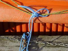 Moustache knot (Nekoglyph) Tags: scarborough yorkshire orange boat harbour marina blue yellow chains rope wood pier knot