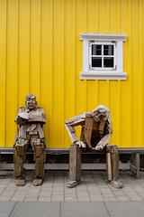 Old men (Christian_Z) Tags: islande iceland bois wood sculpture fenêtre window jaune yellow thinking penseur bonhomme men siglufjörður port harbour panasonic14140mmf3556 travel voyage discover roadtrip bagpack gx7 panasonic