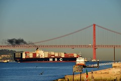 Shipping leaves the Lisbon Harbour, Portugal (swbsnaps) Tags: lisbon portugal sun sunny weather nature river sea europe boat ocean bridge golden gate birds composition