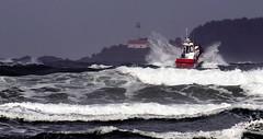 Coast Guard at Cox Bay (John A. McCrae) Tags: coxbay coastguard coast westcoast pacificocean pacificrim ocean seascape vancouverisland waves boat lighthouse