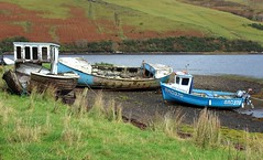 Boats ashore on Skye (Dave Russell (1.5 million views thanks)) Tags: boat boats ship ships vessel vessels vehicle vehicles transport fish fishing work workboat wreck wrecks outdoor loch sea water ocean harport isle island skye west western scotland inner hebrides shore shoreline coast coastal scene scenery landscape grass trawler lifeboat brd370 370 brd girl lauren