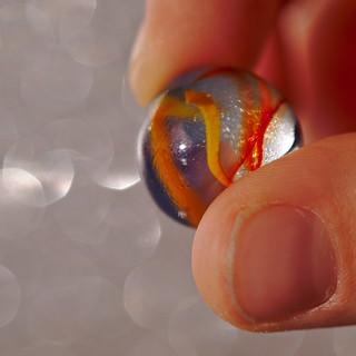Marble between Fingertips