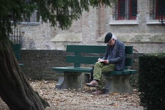 Finding the right words.  Bruges, Belgium. (Andy Ziegler) Tags: people writing solitude thought artist portrait bruges belgium flanders europe bench sitting poet author peace quiet fashion beret reading