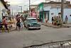 Cross Roads (againandagain251) Tags: camaguey cuba classiccar taxi bicycle residentialstreet fruitstalls colourfulbuildings