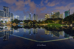 Symphony KLCC, November 2017 (Nur Ismail Photography) Tags: hdr nightphotography nighthdr nurismailmohammed nurismail nurismailphotography frozenlite reflection lake lights construction klccpark kualalumpur architecture buildings water trees