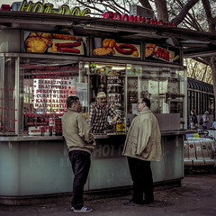 A chat in Vienna (madmtbmax) Tags: austria citypics country stadt wien city österreich man men hotdog wurst sausage kiosk stand chat chatting friend friends hamburger scene walkby travel hungry bier beer talk talking standing shopkeeper vienna fun vintage colour retro colouring