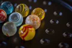 Whimsical marbles (Karon Elliott Edleson) Tags: macromondays gamesorgamepieces closeup games marbles planets tamron 60mm canon7d 7dwf freechoicemondays