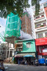 getting grown over (kuuan) Tags: omzuikoautowf2824mm om olympus 24mm f28 mf manualfocus saigon hcmc vietnam street ilce7 architecture old new change