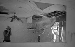 Limp Fan (PositiveAboutNegatives) Tags: leica leitz leicaflexsl 35mmelmarit film analog adox bw blackandwhitefilm rodinal coolscan derelict empty deserted motel hotel