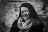 Rachael (tim.perdue) Tags: portrait girl woman person figure senior photo black white bw monochrome face hair smile scarf stone wall nikon d5500 1685mm nikkor