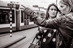 which tram to take (Gerard Koopen) Tags: nederland netherlands amsterdam capital city bw blackandwhite blackandwhiteonly people woman women tram straat street straatfotografie streetphotography fujifilm fuji xpro2 35mm 2017 gerardkoopen