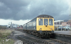 WREXHAM CENTRAL DMU (Malvern Firebrand) Tags: class 108 blue 2car unit waits patiently depart wrexham central approx 19811982 clwyd wales railway station platform outdoors rail centrally outside uk gb dmu multiple grey sky cloud dereliction
