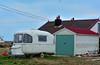 Denver Wellington (tcees) Tags: romneymarsh dungeness kent caravan house garage grass chimney nikon d5200 1855mm sky bird wheelclamp wellingtonboot building uk