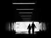 follow the light (Sandy...J) Tags: olympus urban street streetphotography sw blackwhite bw monochrom underpass tunnel people walking light darkness atmosphere city noir grafitti photography silhouette