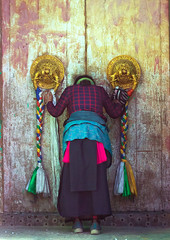 Tibetan woman praying in front of a traditional door in Rongwo monastery, Tongren County, Longwu, China (Eric Lafforgue) Tags: amdo antique architecturaldetail art asia asian bowing buddhism china china17165 chinese colourimage copyspace cultural cultures decoration door doorknob doorway entrance entryway fulllenght heritage huangnan knocker longwu oneadultonly onepersononly onewomanonly ornate portal prayer prayerflag praying qinghaiprovince rearview ronggonchen rongpo rongwo tibetan tibetanautonomousprefecture tongren unrecognizablepeople vertical women worldtravel