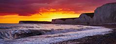 Sunset over Seven Sisters (Greg Webb) Tags: sunset sea beach cliffs chalk summer evening sussex southdowns